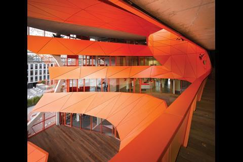 The atrium is a dynamic vortex that reconfigures the Orange Cube's light and spatial characteristics